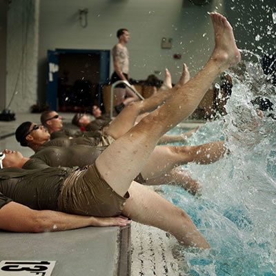 U.S. marines and sailors exercise in a pool
