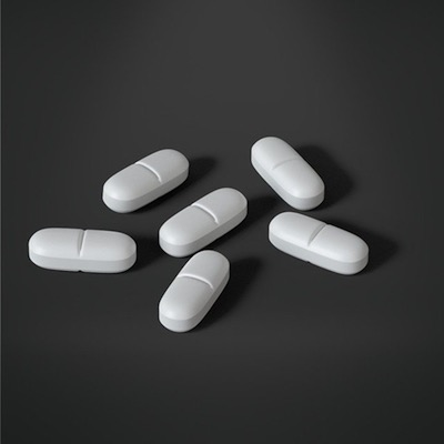 white pills on gray background