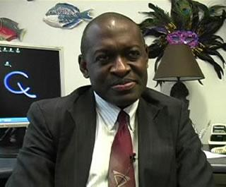 Dr. Alex Adjei sitting in an office