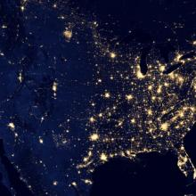 map of the USA showing lights in major cities during the night