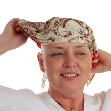 bald female cancer patient with a head scarf