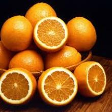 pile of uncut and cut oranges